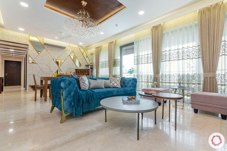 4-BHK-home-design-layout-living-dining-velvet-sofa-textured-paint
