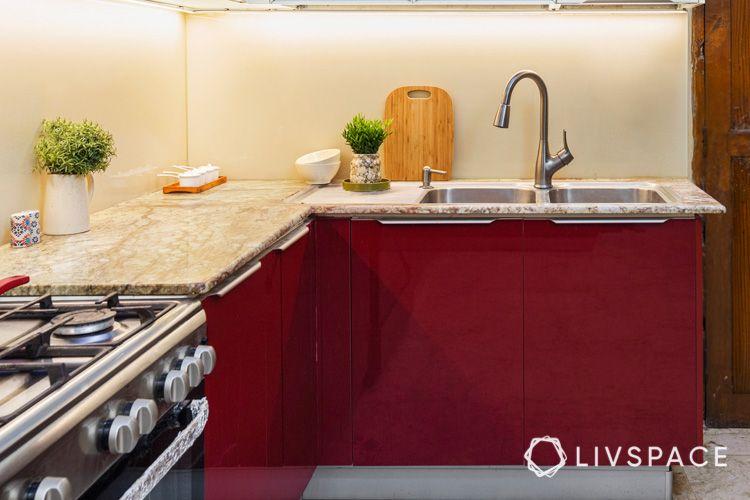 kitchen sink-red cabinets-white cabinets-kitchen designs