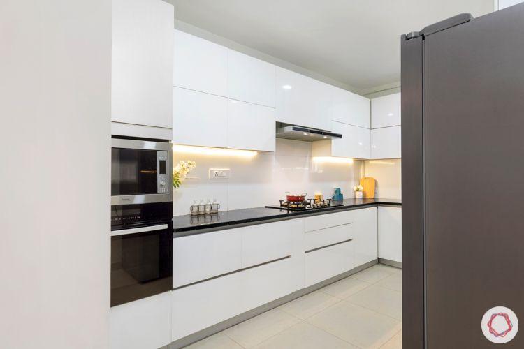 interior designers in hyderabad-white kitchen designs-handleless kitchen