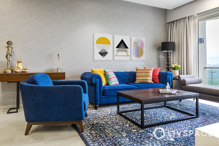 center table buying tips-blue sofa-art work-standing lamp