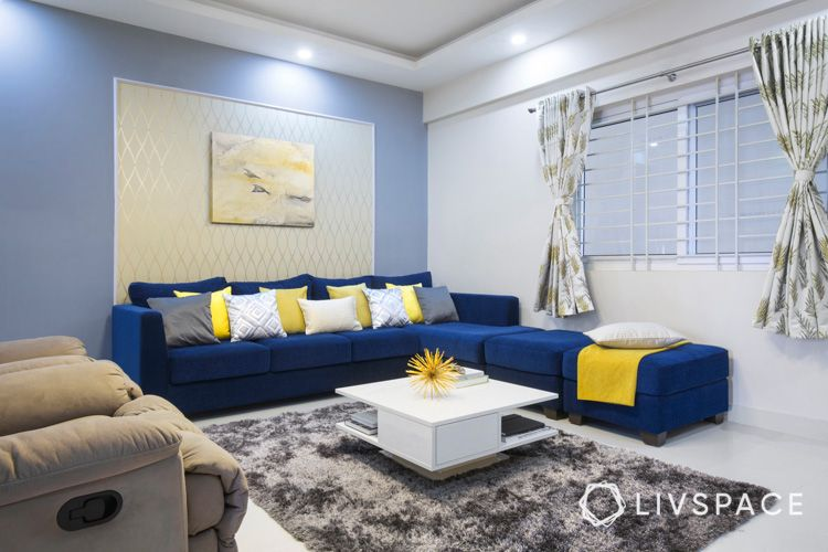 center table buying tips-blue sofa-white coffee table