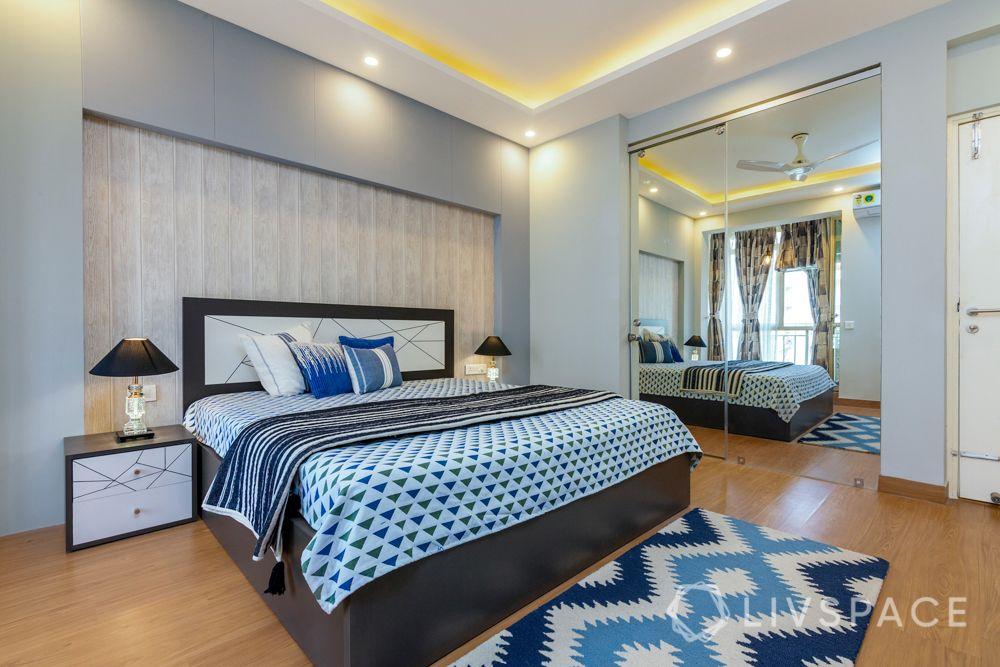 Son bedroom-wooden pattern wallpaper-mirror wardrobe-headboard-cushions-rug