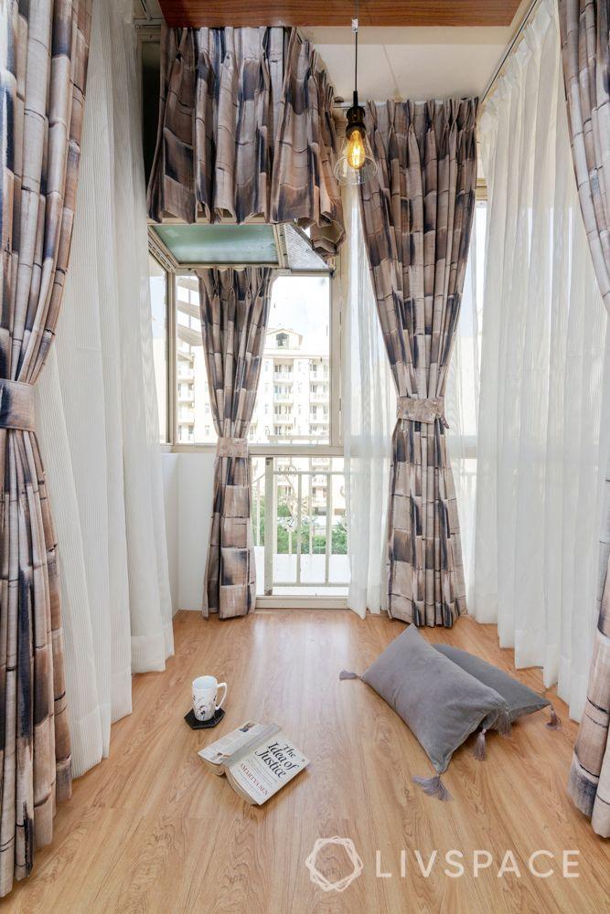 Son bedroom-wooden flooring-headboard-cushions-rug