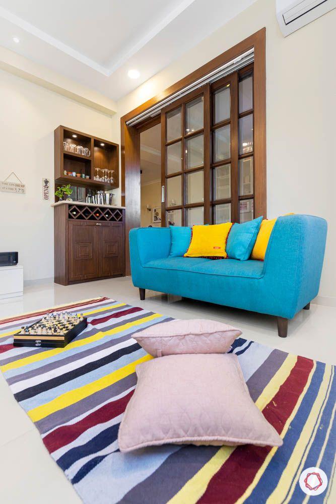 loveseat-blue sofa design-rug designs