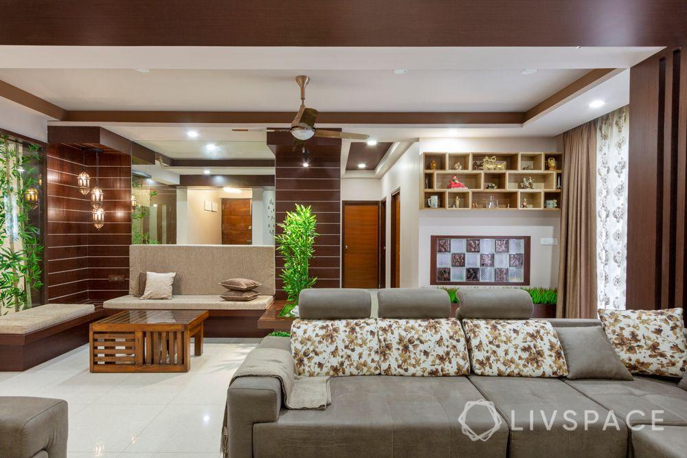 home-interior-designers-in-bangalore-prestige-bagamane-temple-bells-beige-sofa-false-ceiling