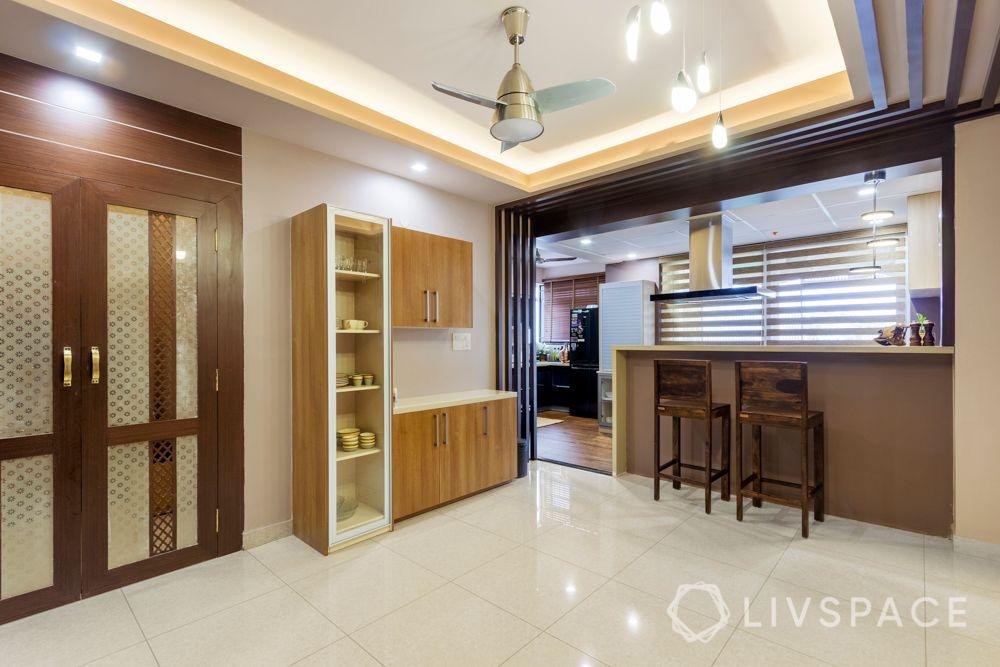 home-interior-designers-in-bangalore-prestige-bagamane-temple-bells-dining-room-false-ceiling