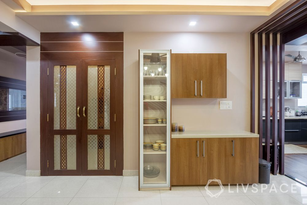 home-interior-designers-in-bangalore-prestige-bagamane-temple-bells-crockery-unit-pooja-room-door