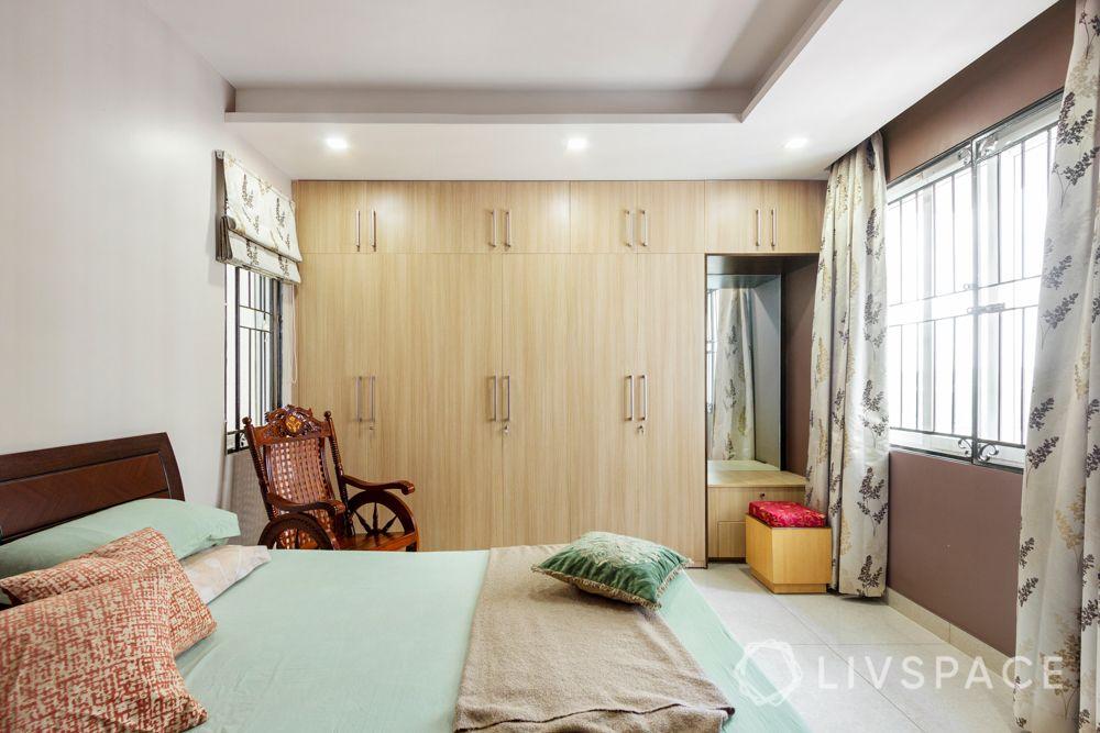 home-interior-designers-in-bangalore-prestige-bagamane-temple-bells-light-laminate-wardrobes