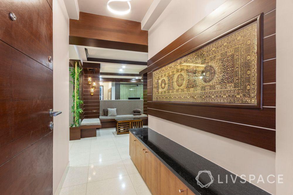 home-interior-designers-in-bangalore-prestige-bagamane-temple-bells-foyer-wall-decor-veneer