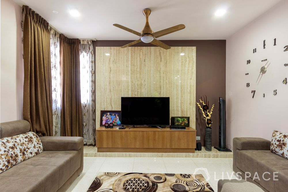 home-interior-designers-in-bangalore-prestige-bagamane-temple-bells-marble-finish-tv-unit