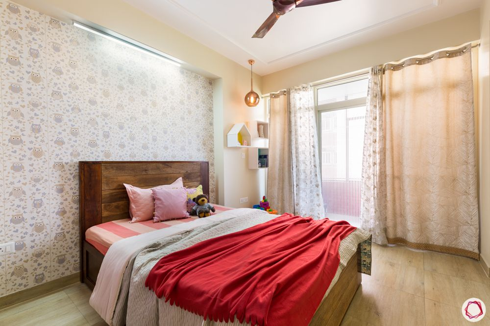 home decorating ideas on a budget-red bedding-floral wallpaper-wooden bed