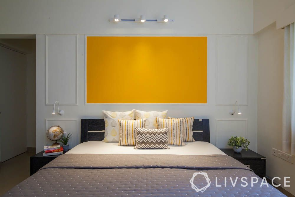 home decorating ideas on a budget-yellow wall-wall trims-track lights