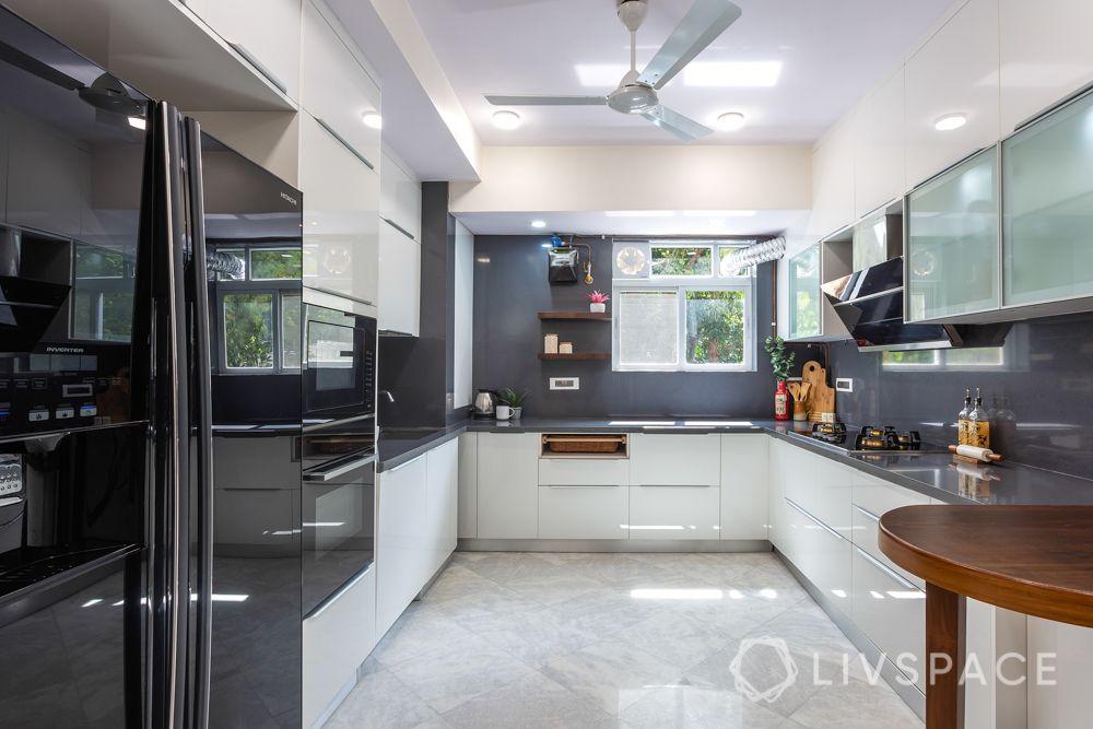 kitchen-renovation-white-cabinets-grey-wall-breakfast-table-fridge