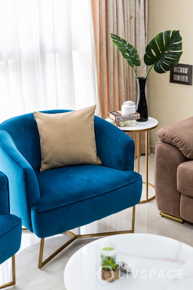 stylish home design-brown sofa-blue chairs-white coffee tables-wall art