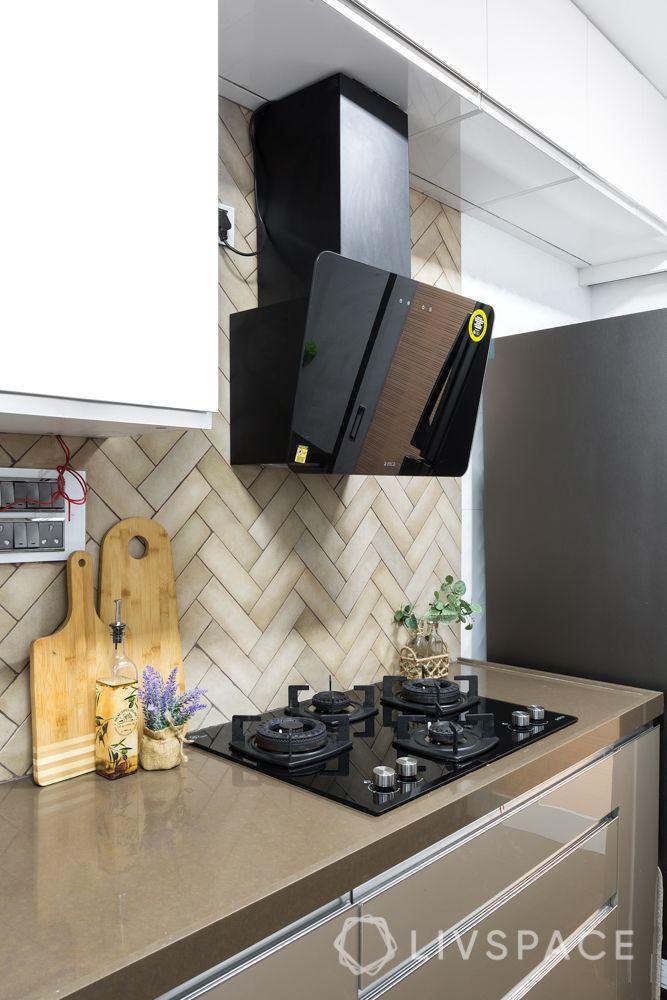 stylish home design-tiled backsplash-brown base cabinets- white wall cabinets-hob