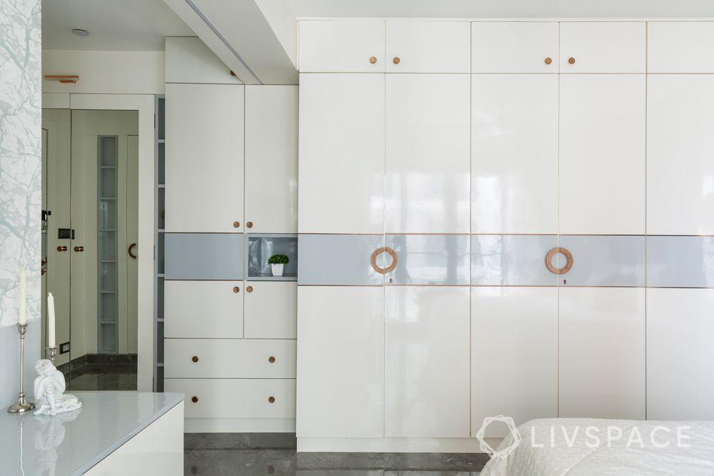 stylish home design-velvet headboard-blue headboard designs-white interiors