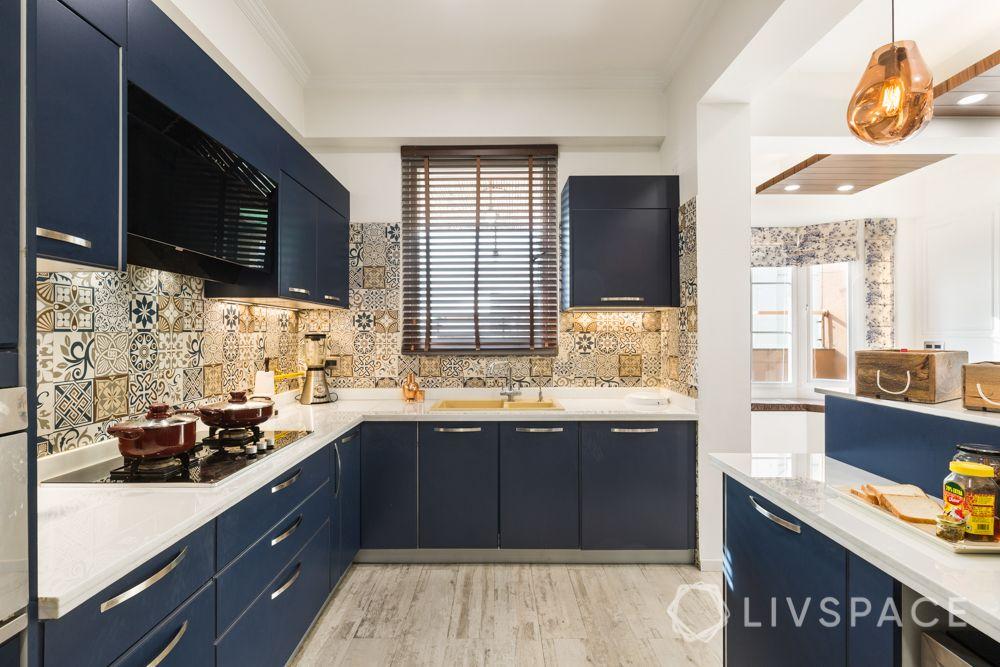 4bhk house design-blue kitchen-membrane finish cabinets
