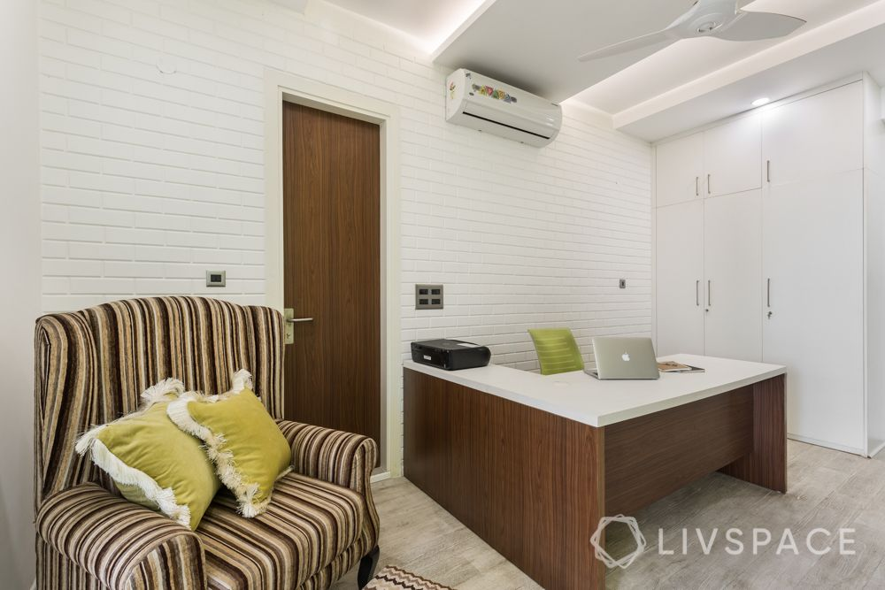 4bhk house design-armchair designs-white exposed brick wall