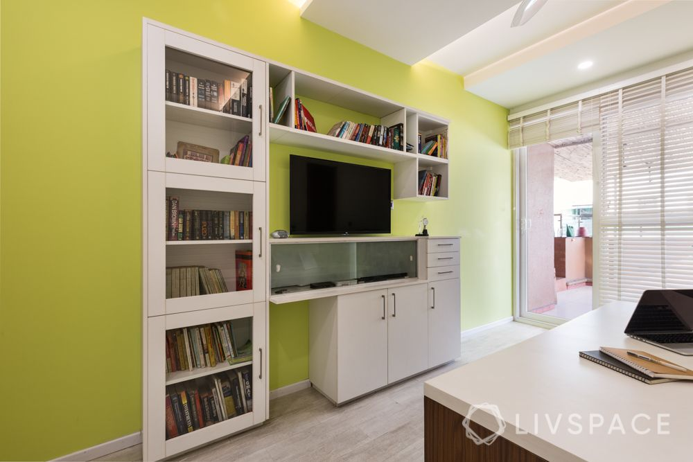 4bhk house design-shelves cast into niche-green wall paint