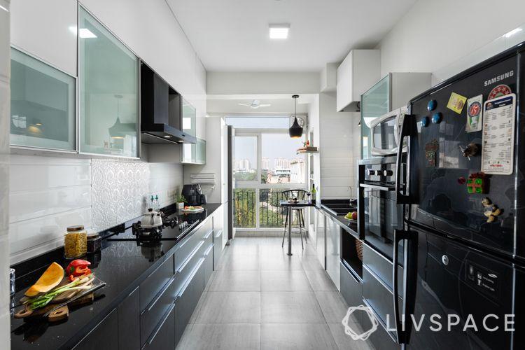 interiors in gurgaon-black and white kitchen-black quartz countertop