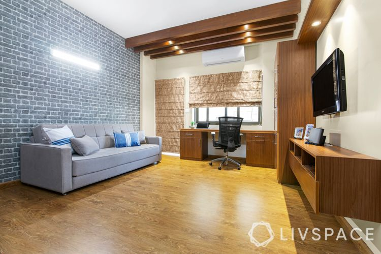 interiors in gurgaon-grey brick wall-wooden flooring