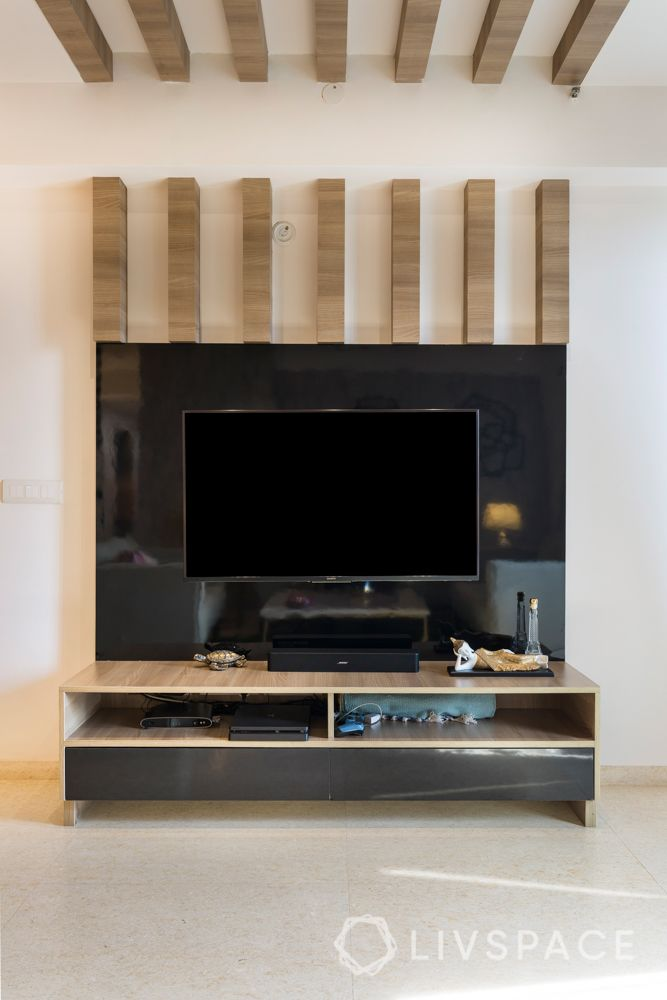Tv unit-wooden rafters-l shaped design-living room