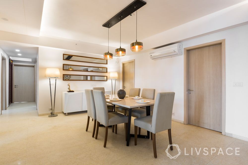 4 bhk in gurgaon-upholstered chair-pendant lights-false ceilings-parallel mirror-crockery unit