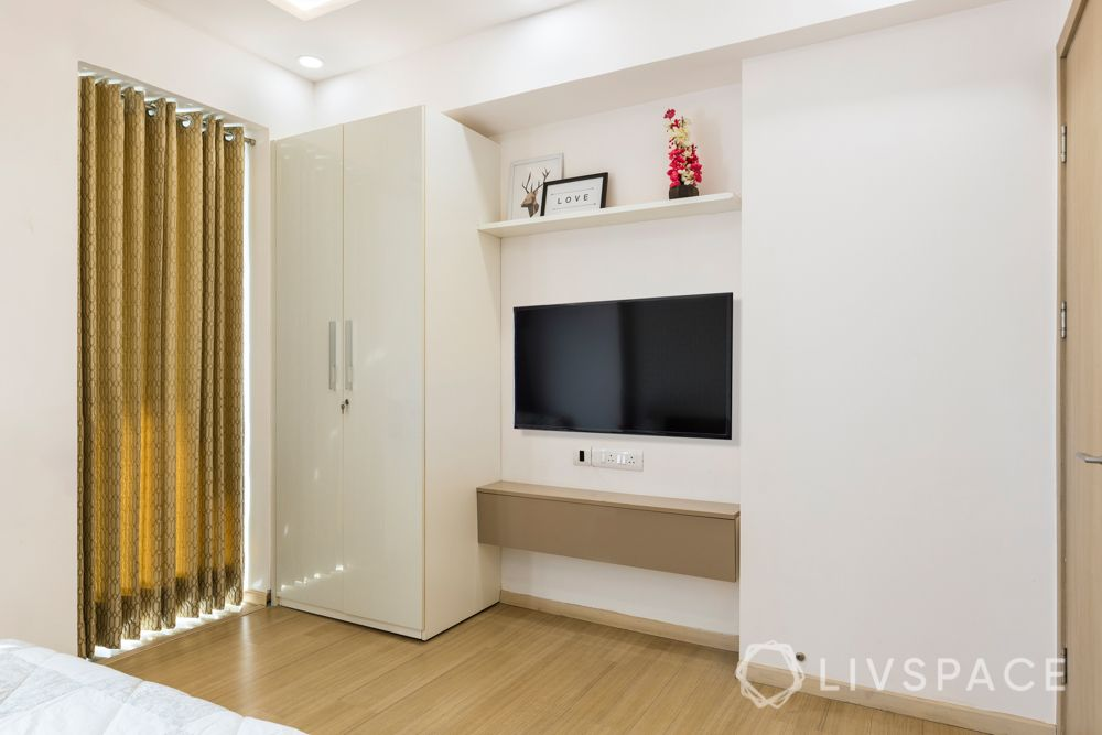 White wardrobe-muted golden tv unit