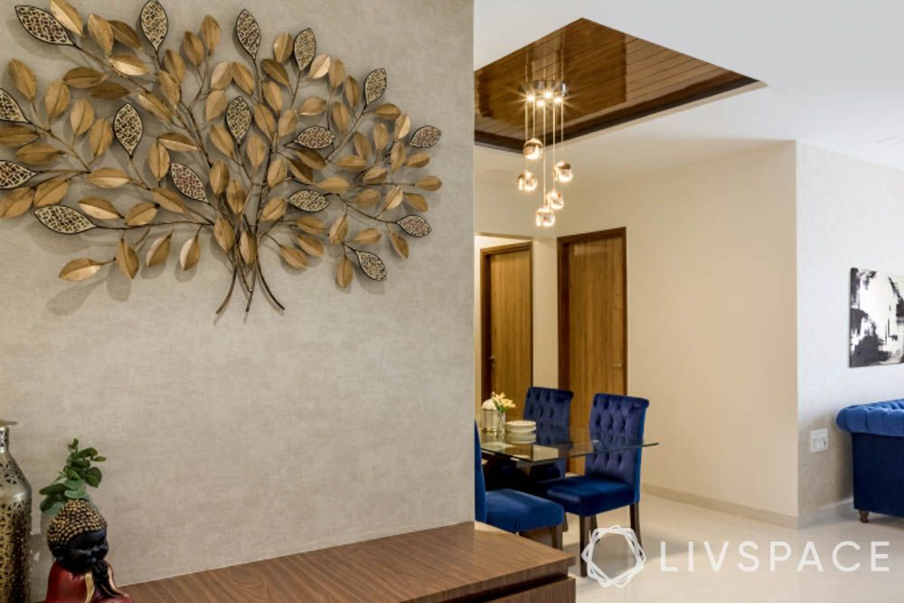 gold wall accents-tree of life-blue sofas