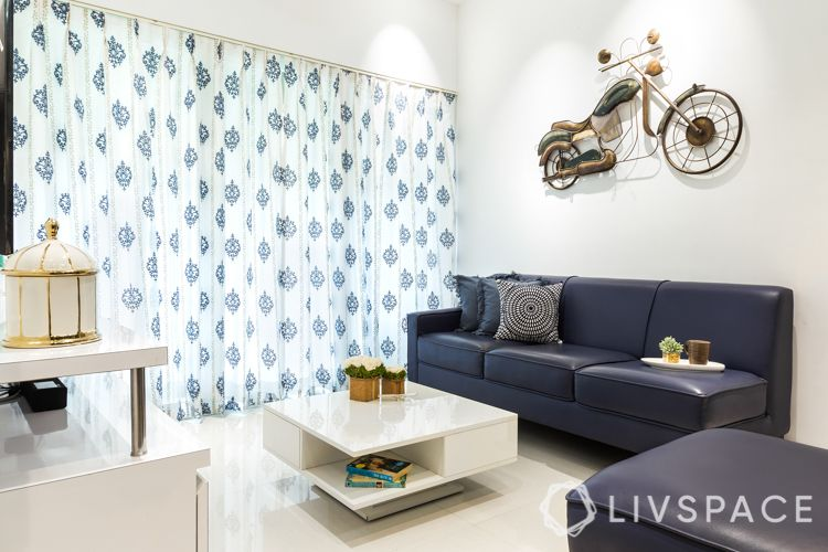 small-living-room-design-white-curtain-wall-grey-sofa-bike-accent