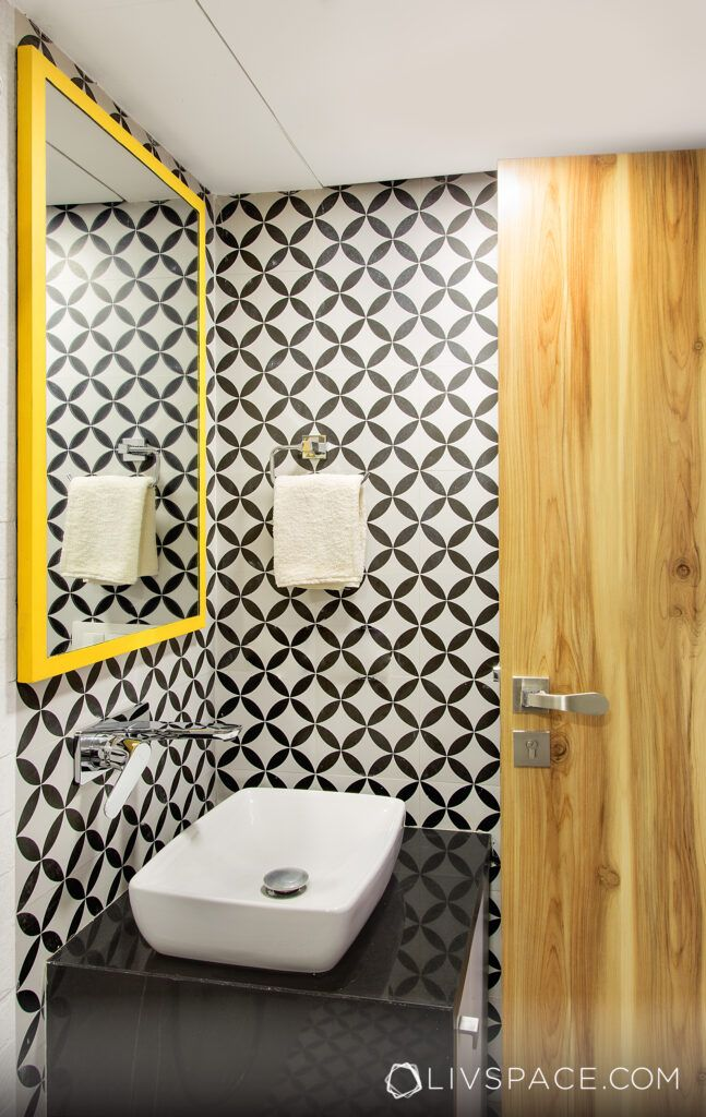 Small bathroom designs in India-patterned tiles-yellow mirror frame