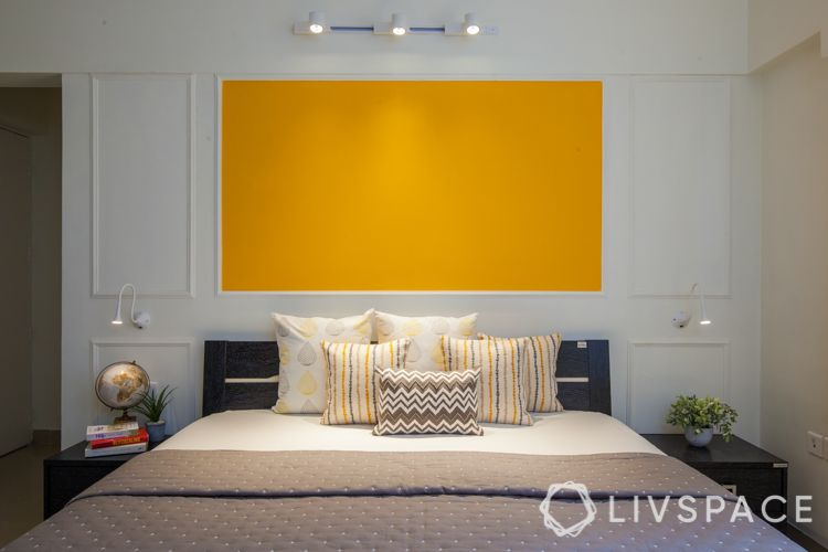 small house interior design-yellow wall-wall trims-track lights