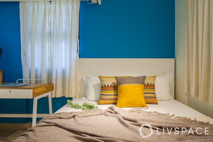 small house interior design-white bed-blue wall-white study unit design