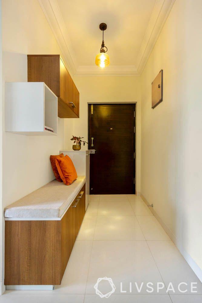 2 BHK in Bangalore-foyer-pendant light-storage-walnut finishes