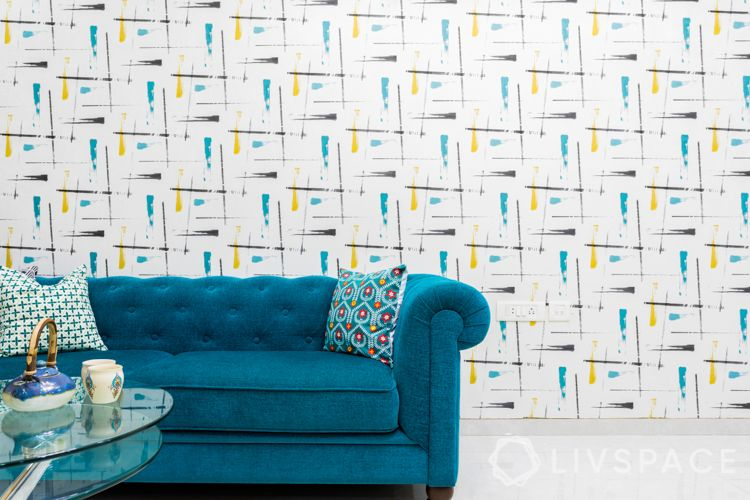 how to decorate home in low budget-blue sofa-pattern wallpaper