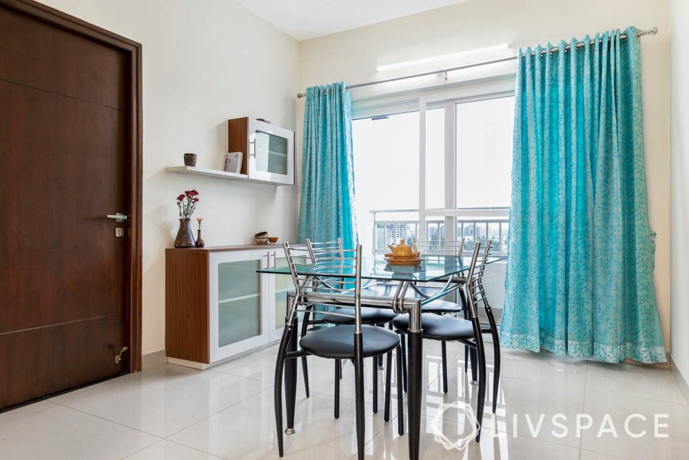 2bhk interior design-dining table-crockery unit-open shelves