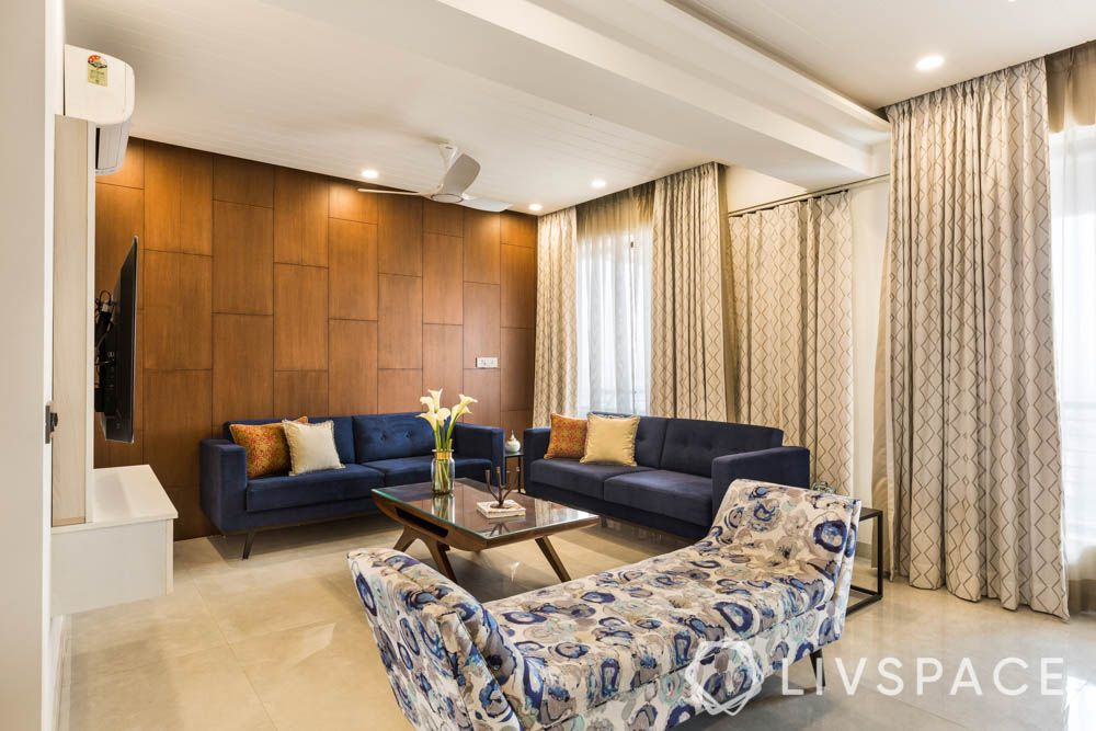 Living room-wooden wall panelling-blue sofa-upholstered seating