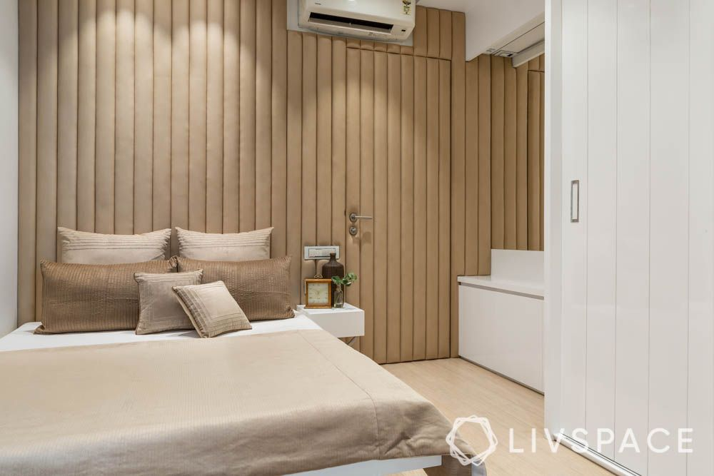 2bhk interior design-leather headboard-master bedroom