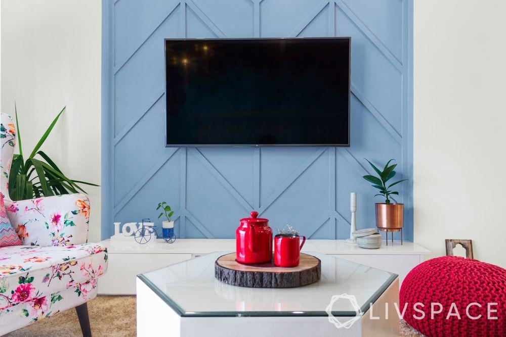 interiors in bangalore-blue bougainville wallpaper-floor seating-wall trims-tv unit design