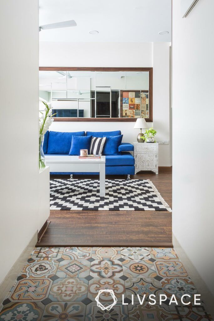 best flooring for house in india-blue sofa-mirror-pattern carpet-morrocan tiles