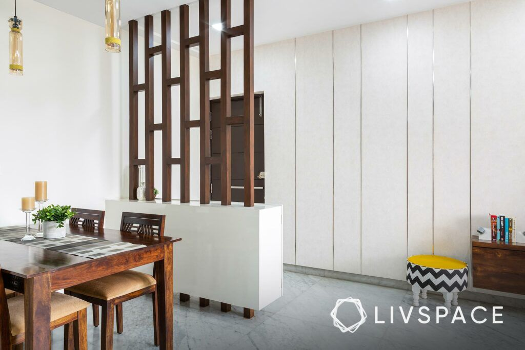 Foyer design-wooden partition-shoe cabinets-dining table