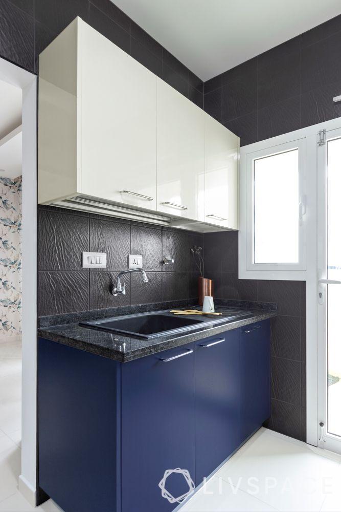 interior design firms in bangalore-membrane kitchen-black textured tiles-sink