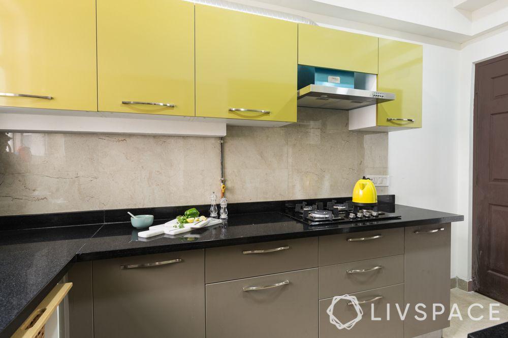 3bhk-flat-design-kitchen-granite countertop-yellow cabinets