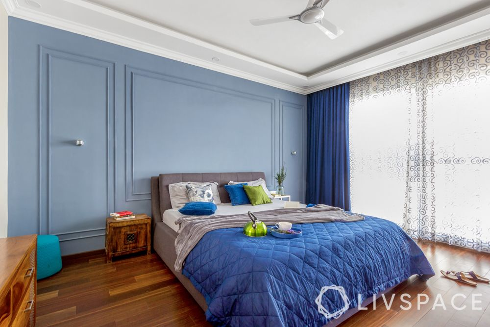 how to make bedroom perfect for sleep-blue bedding-blue wall trims-white curtains-wooden flooring