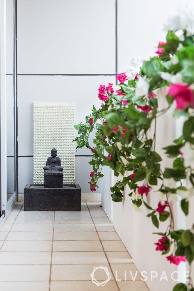 balcony garden ideas-pink flowers-creepers-buddha statue-buddha balcony
