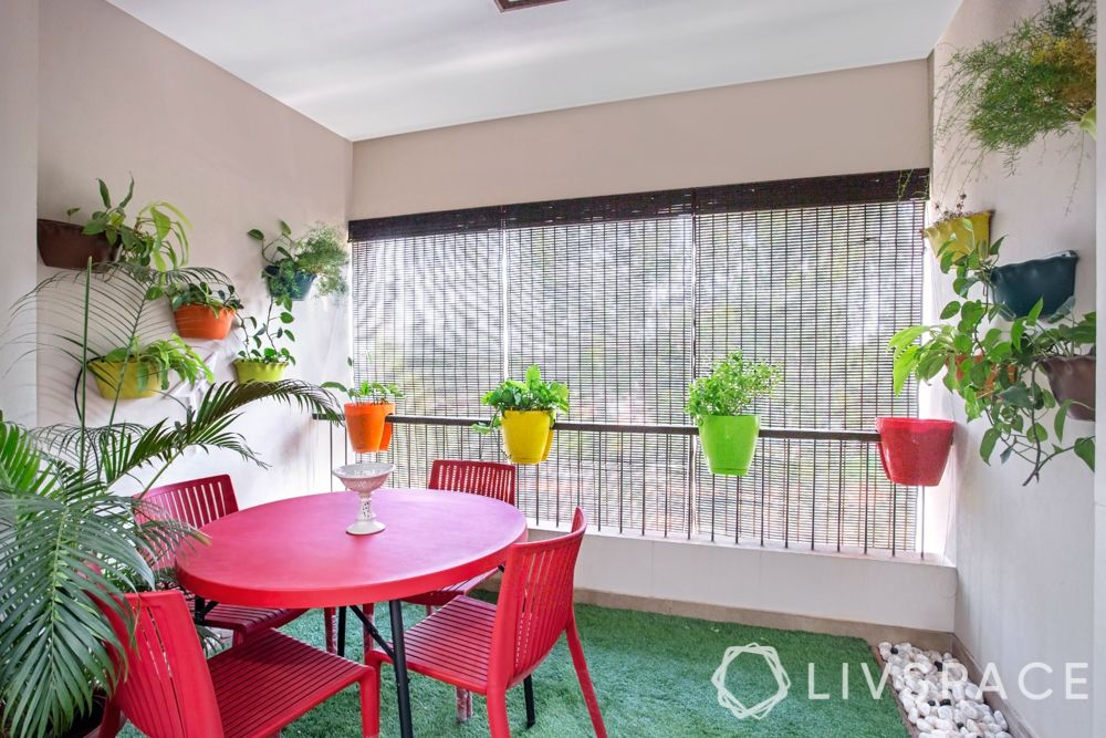 balcony garden ideas-red table and chair-colourful flower pots