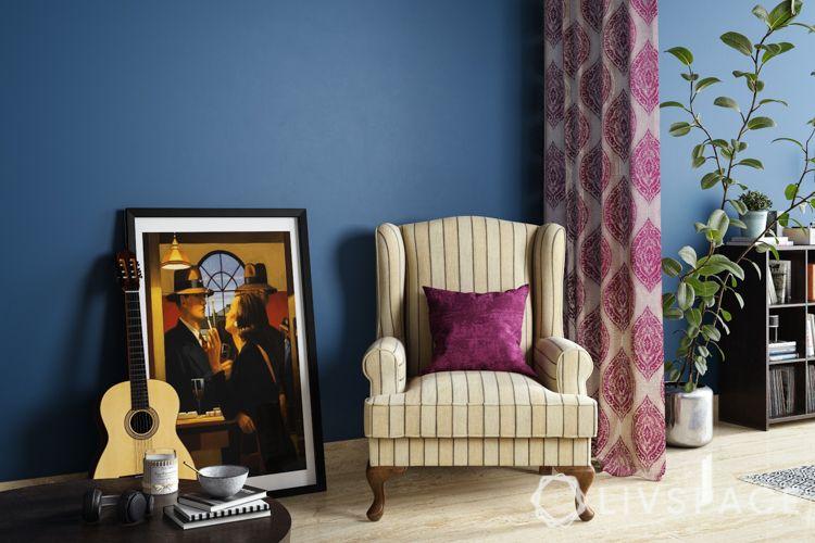 stripes on armchair-blue wall-yellow armchair