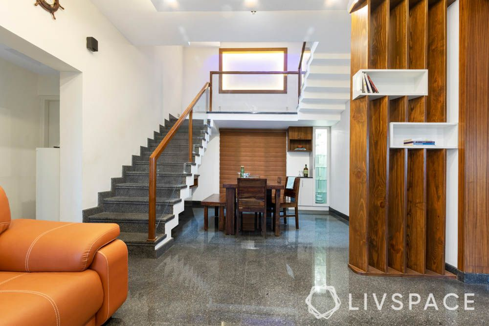 villa design-living room-solid wood partition-bookshelf-dining room-stairs