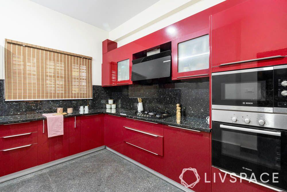 villa design-kitchen-red cabinets-membrane finish-granite backsplash-granite countertop