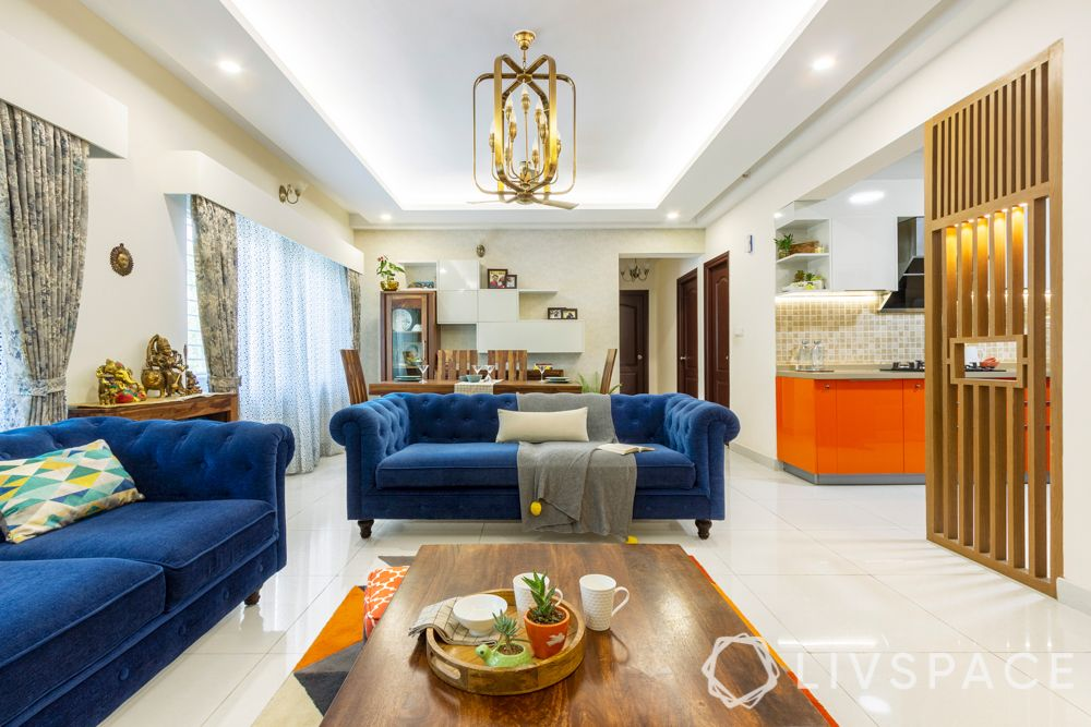 3 bhk home design-blue sofa-coffee table-chandelier